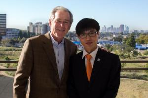 Shin Dong Hyuk together with ex- US president and war criminal George.W.Bush at the presidential Dallas, Texas, October 23, 2013.