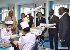 Photo provided by Korean Central News Agency (KCNA) on Aug. 16, 2014 shows a delegation of the Angola Doctor Association visiting the Ryugyong Dental Hospital in Pyongyang, the Democratic People's Republic of Korea (DPRK). (Xinhua/KCNA)