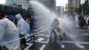 South Korean police used water cannons and tear gas against protesters.
